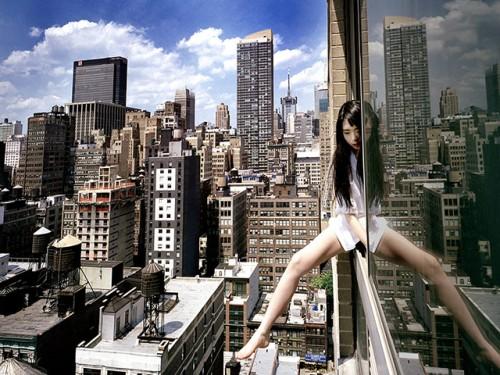 A self portrait of Jun Ahn dangling from a skyscraper