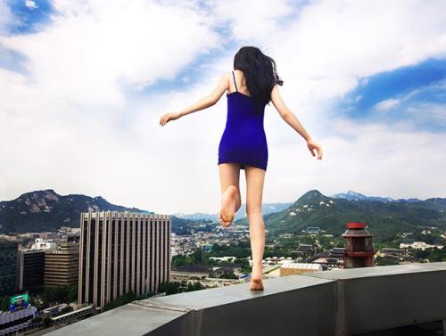 A self portrait of Jun Ahn on a skyscraper